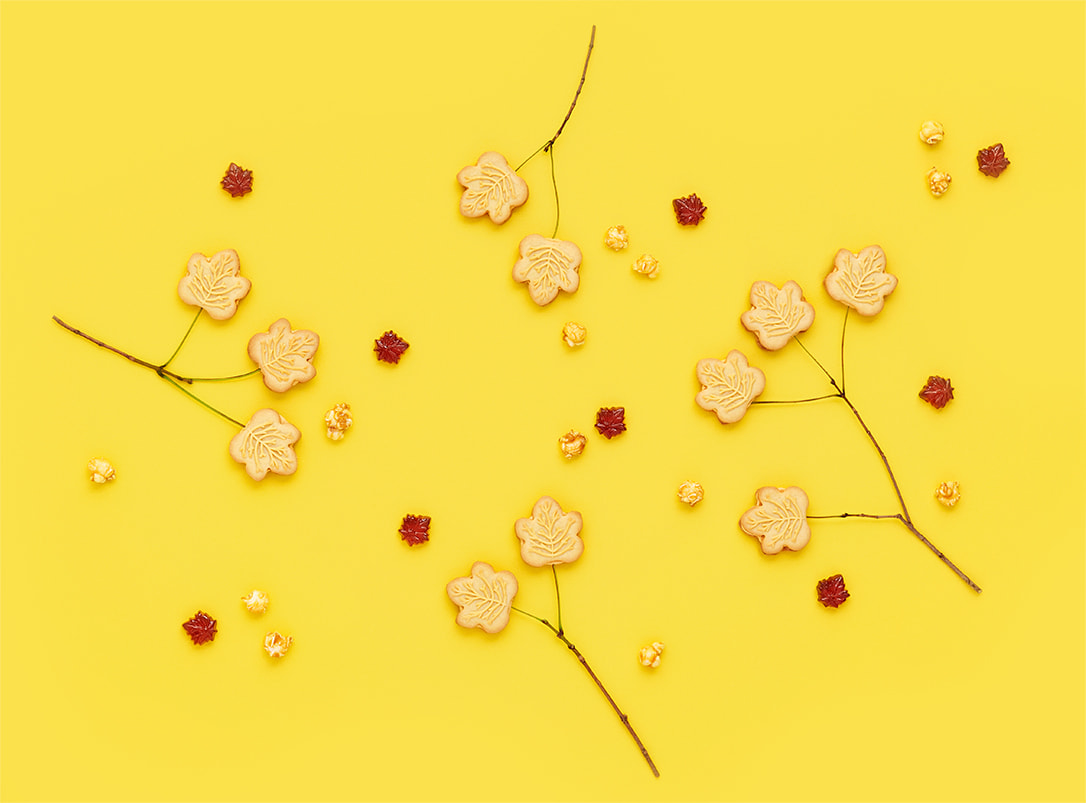 Yellow background with maple syrup cookies arranged like trees.