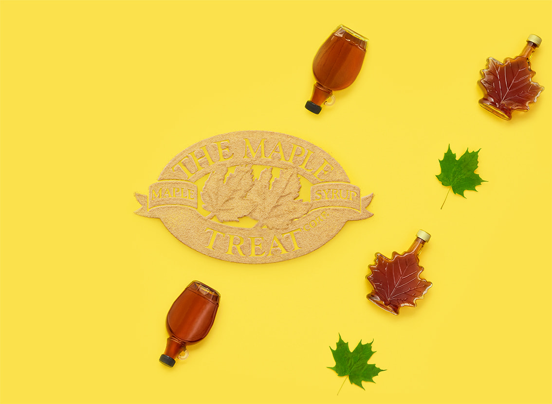 The Maple Treat Corp.  logo made with maple sugar with bottles of maple syrup and maple leaves surrounding it.